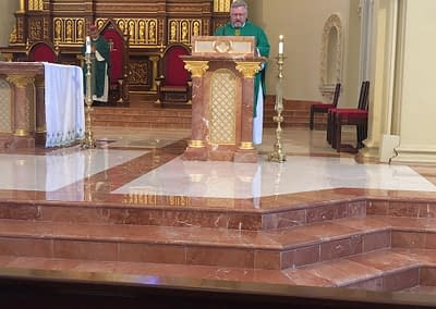 Father Pollard Reading the Gospel at St. Stephen